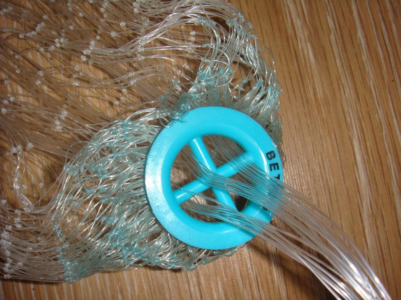 Процесс плетения рыболовной сети